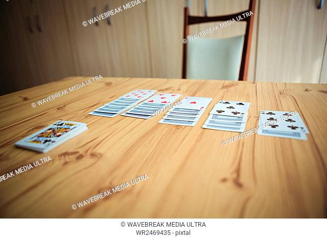 Close-up of cards on a wooden table