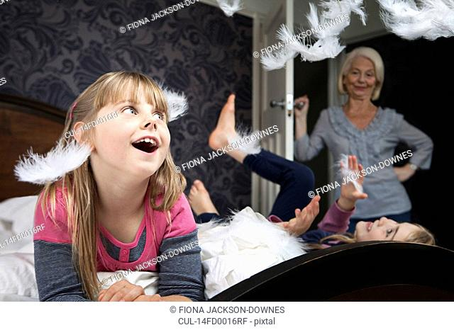Girl watches feathers after pillow fight