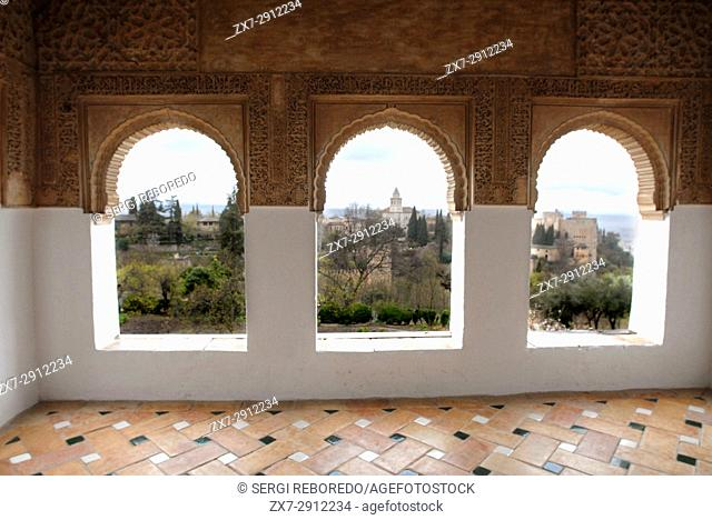 Decorated arches and windows of the Mexuar Courtyard of the Comares Palace in the Alhambra in Granada, Andalucia, Spain