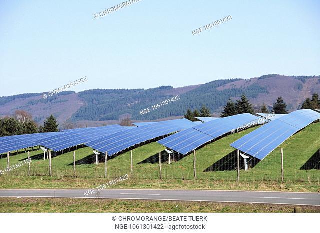 Solar panels on the green meadow in the Eifel