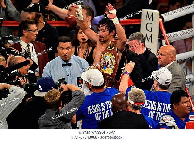 April 9, 2016; Las Vegas, Nev., USA; Manny Pacquiao (Sarangani Province, Philippines) raises his arms in victory after the Pacquiao vs