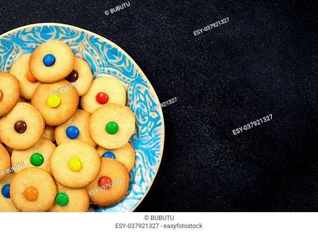 Homemade cookies on a plate - black background - copy space