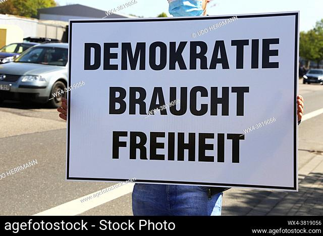 Rally against Corona measures, Germany: Demonstrators express their criticism of corona policies with an approved sign action in Industriestrasse in...