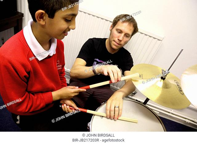 Visually impaired boy being given drumming lessons at Mysight charity, Nottingham