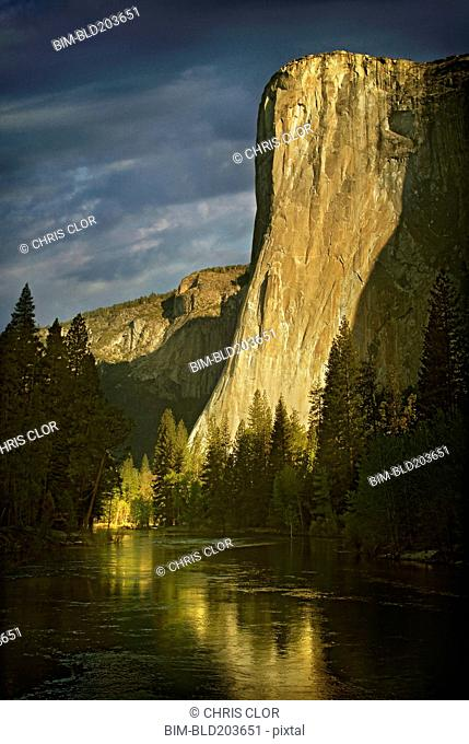 Rock formation reflected in still rural lake, Yosemite, CA, United States