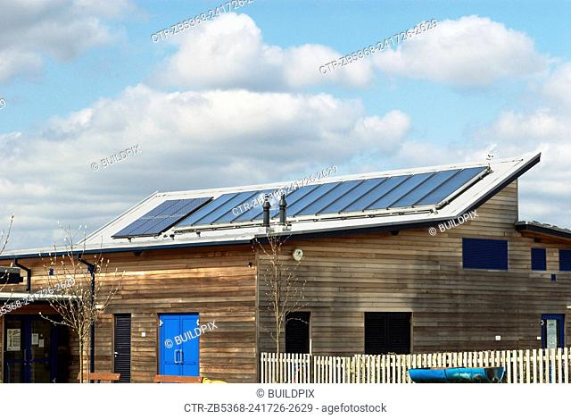 Solar heat collector panels to heat hot water and western cedar cladded walls at the Beaumont Community Primary School, Hadleigh, Suffolk, UK