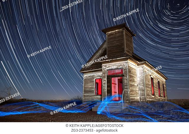 Abandoned Taiban Presbyterian Church in New Mexico at night with star trails