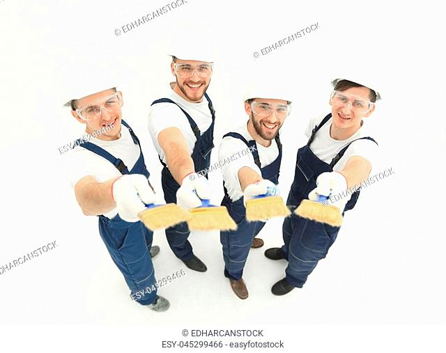 team of construction workers looking at the camera.isolated on white.photo with copy space