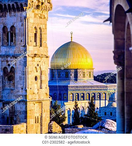 Bab Al-Ghawanima minaret and Dome of the Rock at sunset Jerusalem Israel