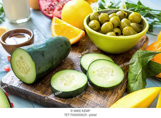 Fresh slices of cucumber and bowl of olives