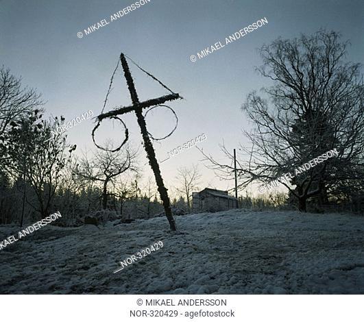 An inclined cross at a snowy garden, Sweden