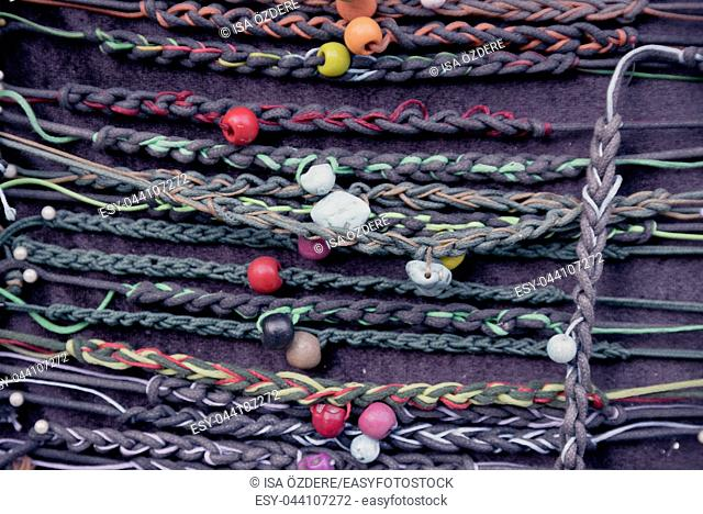 Lots of colorful variety hippy retro bracelets of handmade for sale on stall