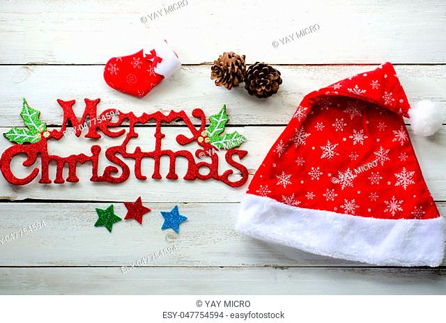 """Christmas decorations and """"""""Merry christmas"""""""" greetings on a wood white background"""