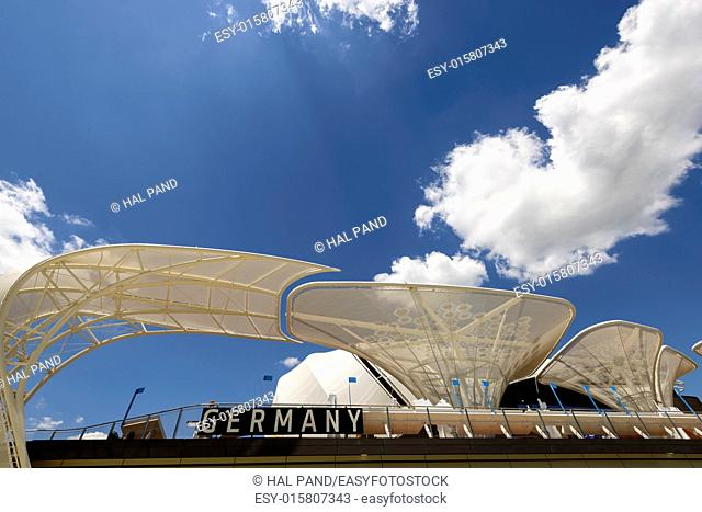 MILAN, ITALY - June 24: bright clouds over structures on roof of German pavilion , shot on jun 24 2015 Milan, Italy