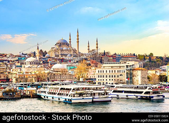 Suleymaniye Camii, the famous mosque on Golden Horn and touristic boats in Istanbul at sunset, Turkey