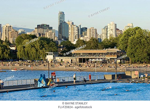 Late day view of people swimming in Kitsilano pool, Vancouver, British Columbia