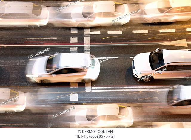 Spain, Madrid, Blurred motion of city traffic in Gran Via street from above