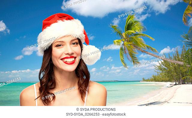 woman with red lipstick in santa hat on christmas