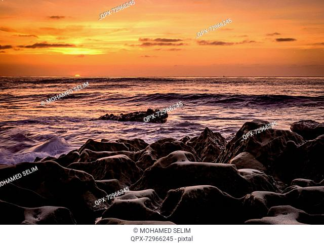 Rugged ocean shore at sunset, San Diego, California, USA