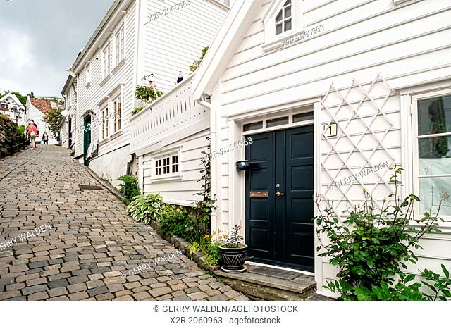 A cobbled street leading through the beautiful old town part of Stavanger in Norway