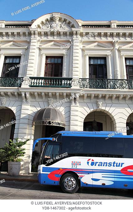 Front View of Hotel Santana and a tourist bus in Old Havana, Havana, Cuba