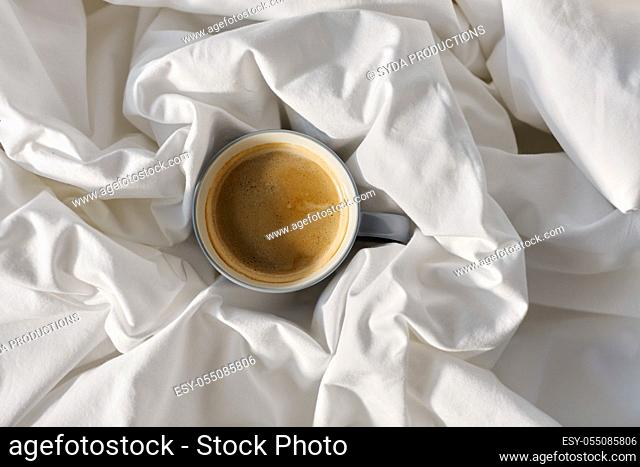 cup of coffee in bed