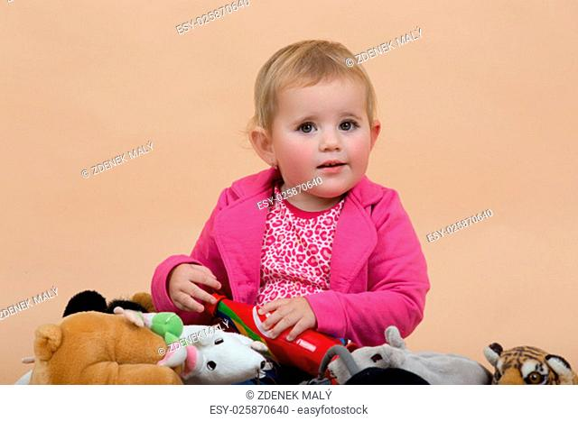 portrait of young cute baby on beige background