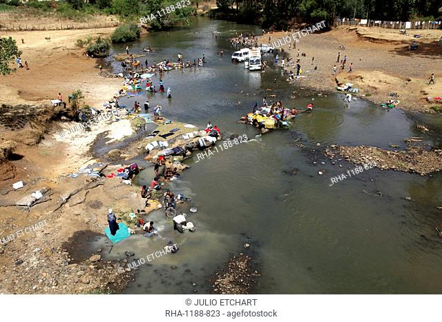 Local people washing and doing their laundry in a river in the highlands of Ethiopia, Africa