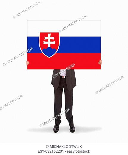 Businessman holding a big card, flag of Slovakia, isolated on white
