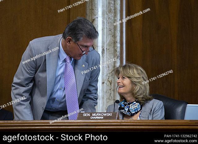 United States Senator Joe Manchin III (Democrat of West Virginia), left, speaks to United States Senator Lisa Murkowski (Republican of Alaska) during the United...