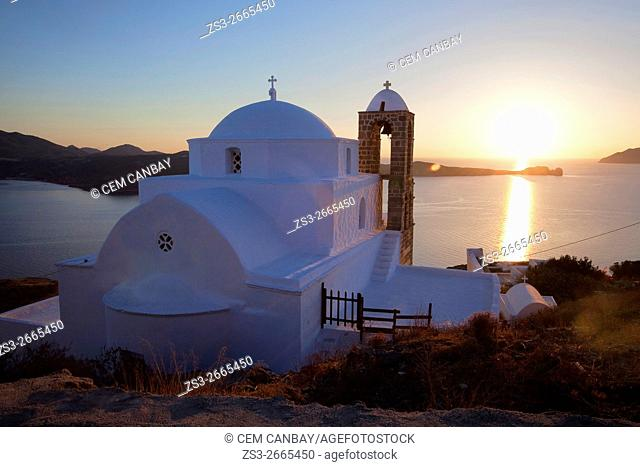 Domed church of Pangia Thalassitra overlooking the sea and the town Plaka at sunset, Milos, Cyclades Islands, Greek Islands, Greece, Europe