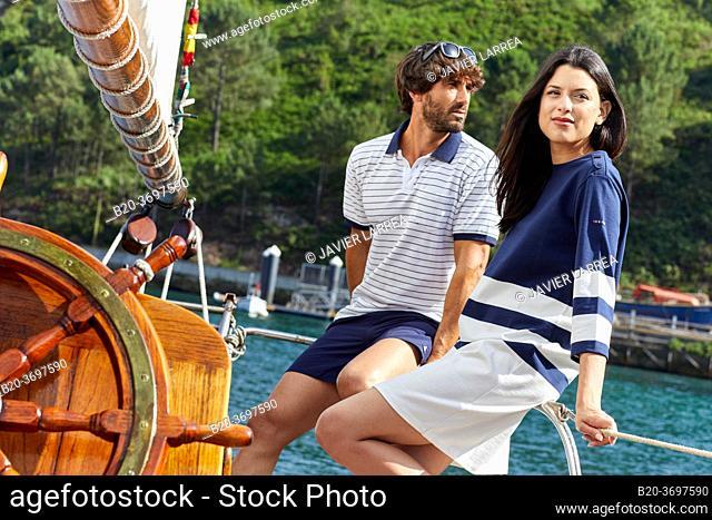 Couple with sailor clothes, Sailboat, Port of Pasaia, Gipuzkoa, Basque Country, Spain, Europe