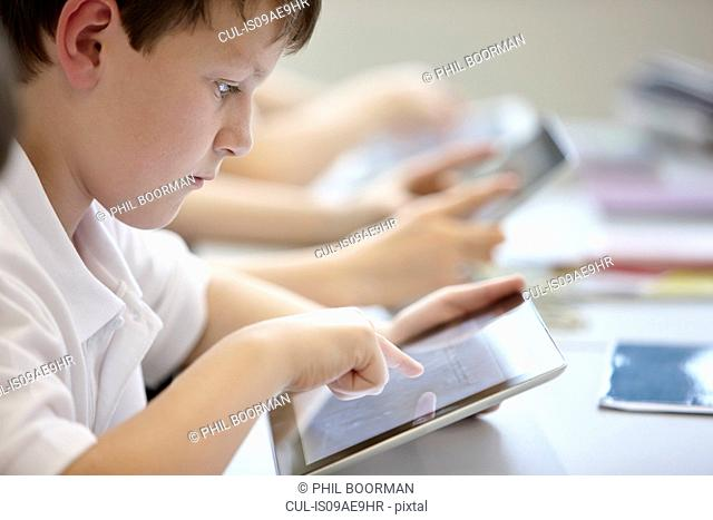 Close up of schoolchildren working in class