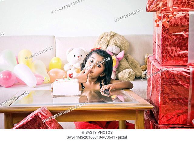 Girl eating a birthday cake