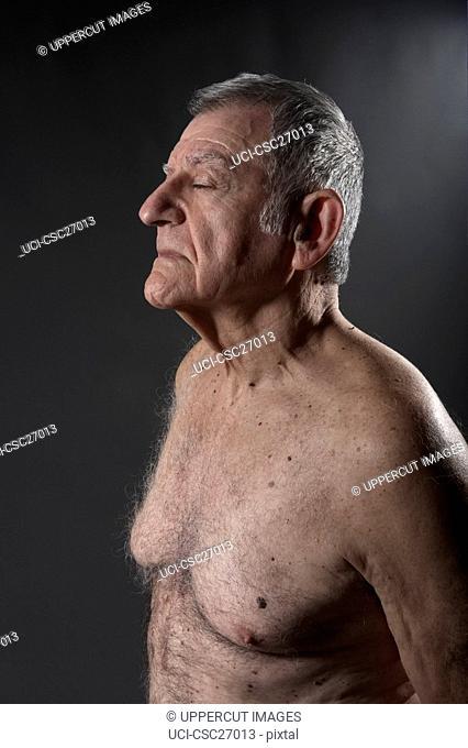 Bare chested senior man