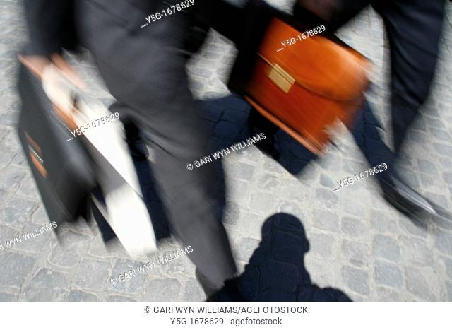 commuters carrying briefcases in town