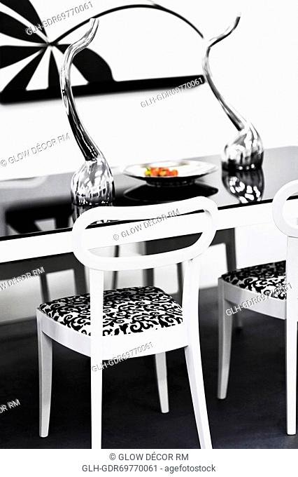 Showpieces on a table with chairs