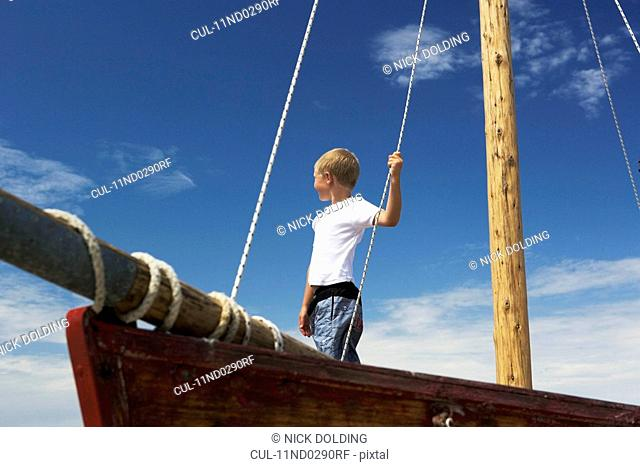 Boy on sailing boat