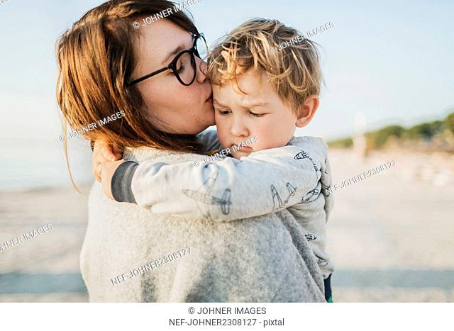 Mother kissing son