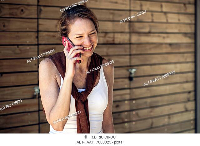 Mature woman talking on smart phone