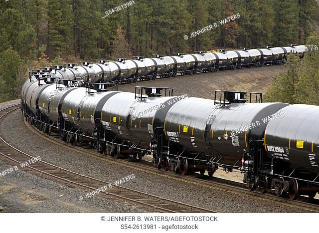 Oil tanker cars on a train hauling oil through Washington State, USA