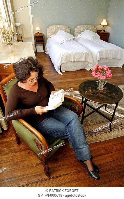 READING IN ON OF THE ROOMS AT THE BED BREAKFAST AT THE CHATEAU DE LA PUISAYE, VERNEUIL-SUR-AVRE, FRANCE