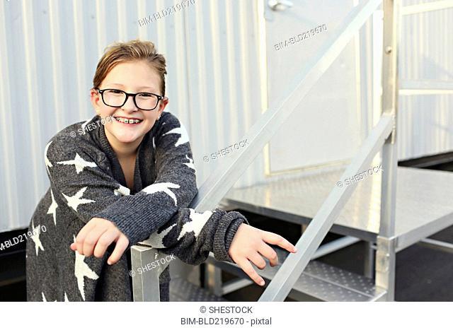 Smiling Caucasian girl standing outside trailer