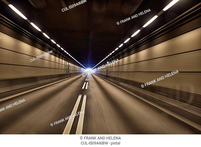 Motion blur view of road tunnel