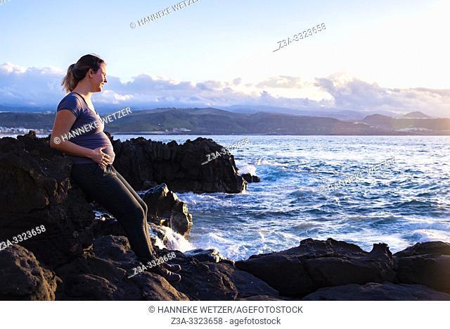 Pregnant woman enjoying the coastline of Las Palmas, Canary Islands