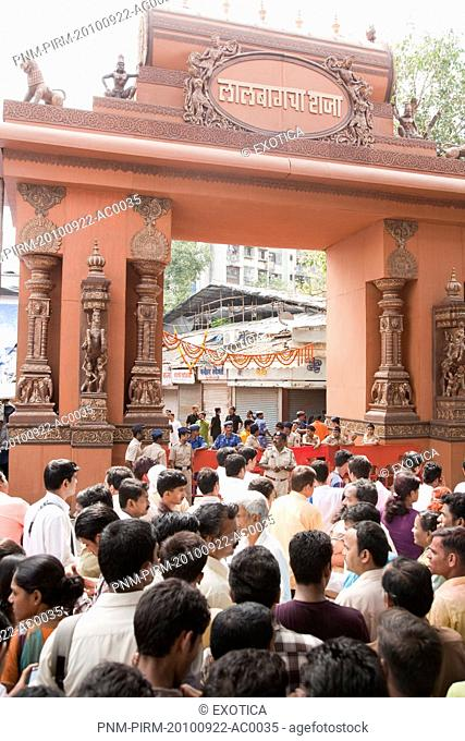 Crowd at the entrance of a temple during religious procession of Ganpati visarjan ceremony, Mumbai, Maharashtra, India