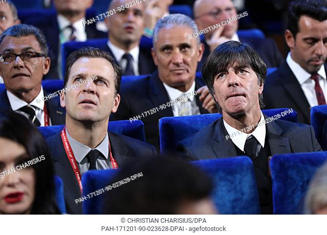 Germany's national football team head coach Joachim Loew (R) sits in the hall with Germany's national football team manager Oliver Bierhoff (L) before the FIFA...