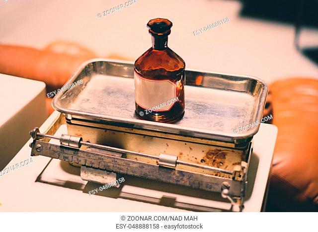 old empty medicine bottle on scale - vintage look