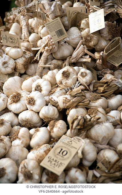 Garlic piled up on a produce stall at Frampton Country Fair, Frampton on Severn, Gloucestershire, UK