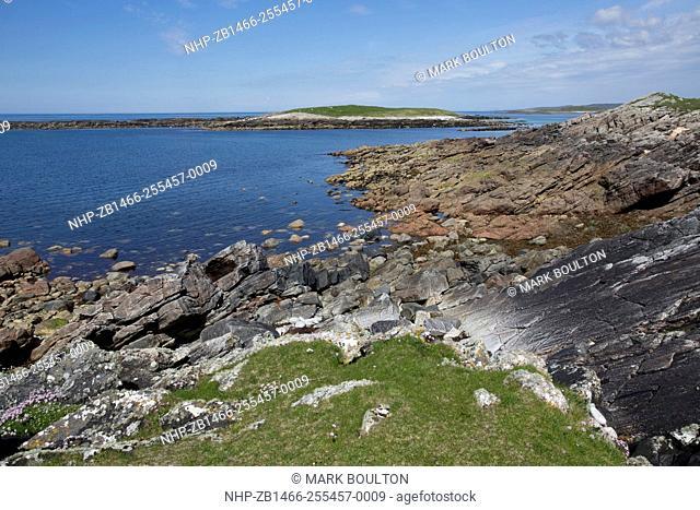 Scenic rocky coastline Balranald Nature Reserve North Uist Outer Hebrides Scotland